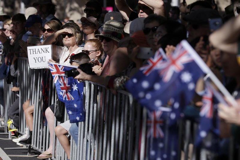 People line a street during a march celebrating ANZAC Day, a national day of remembrance in Australia and New Zealand that commemorates those that served and died in all wars, conflicts, and while peacekeeping, in Sydney, Australia, Thursday, April 25, 2019. (AP Photo/Rick Rycroft)