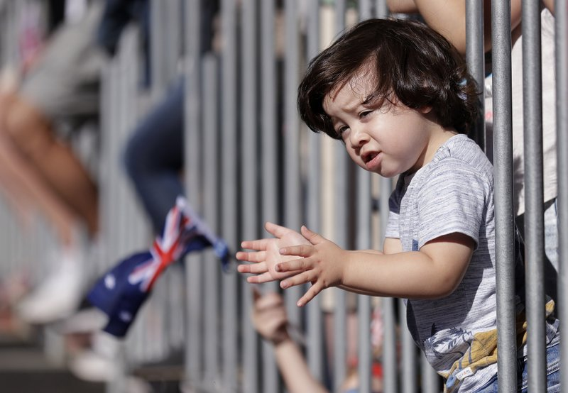 Two-year-old Sabastian Nunez claps his hands as he watches a march celebrating ANZAC Day, a national day of remembrance in Australia and New Zealand that commemorates those that served and died in all wars, conflicts, and while peacekeeping, in Sydney, Australia, Thursday, April 25, 2019. (AP Photo/Rick Rycroft)