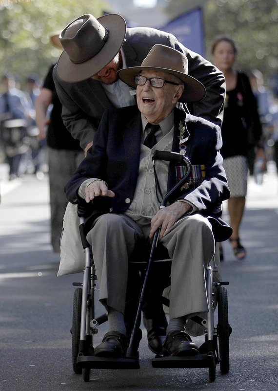 World War II veteran 103-year-old Bert Collins is pushed in his wheelchair during a march celebrating ANZAC Day, a national day of remembrance in Australia and New Zealand that commemorates those that served and died in all wars, conflicts, and while peacekeeping, in Sydney, Australia, Thursday, April 25, 2019. (AP Photo/Rick Rycroft)