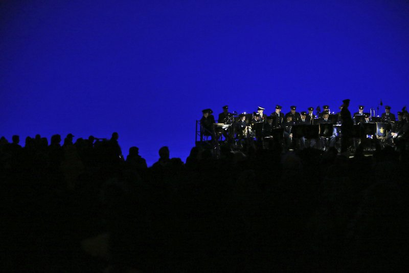 Army officers observe a minute of silence during the Dawn Service ceremony at the Anzac Cove beach, the site of World War I landing of the ANZACs (Australian and New Zealand Army Corps) on April 25, 1915, in Gallipoli peninsula, Turkey, early Thursday, April 25, 2019. (AP Photo/Emrah Gurel)