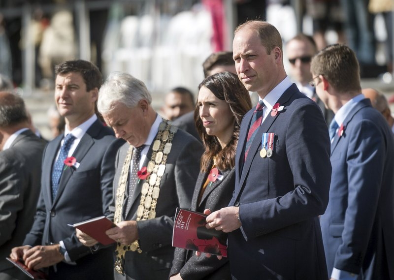 Britain's Prince William, front right, and New Zealand's Prime Minister Jacinda Ardern, second right in front, attend an  Anzac Day service at Auckland War Memorial Museum in Auckland, New Zealand Thursday, April 25, 2019. (Mark Tantrum/The New Zealand Government via AP)
