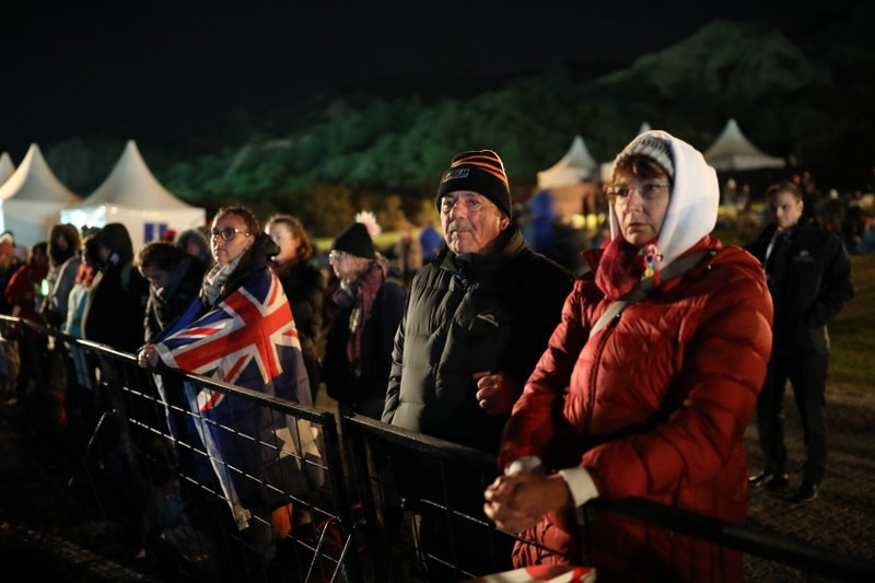 People wait for the Dawn Service ceremony at the Anzac Cove beach, the site of World War I landing of the ANZACs (Australian and New Zealand Army Corps) on April 25, 1915, in Gallipoli peninsula, Turkey, early Thursday, April 25, 2019. (AP Photo/Emrah Gurel)
