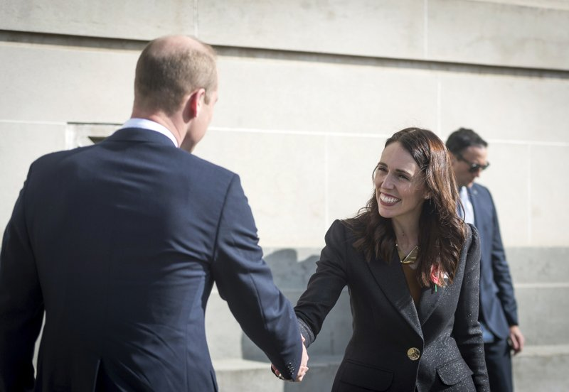 Britain's Prince William and New Zealand's Prime Minister Jacinda Ardern shake hands as they attend an Anzac Day service at Auckland War Memorial Museum in Auckland, New Zealand Thursday, April 25, 2019. (Mark Tantrum/The New Zealand Government via AP)