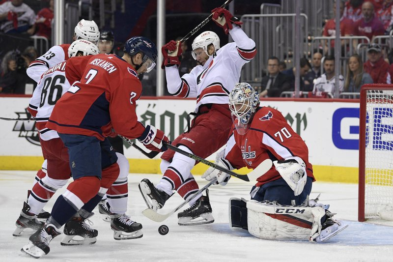 Carolina Hurricanes center Jordan Staal, center, battles for the puck against Washington Capitals goaltender Braden Holtby (70) and defenseman Matt Niskanen (2) during the first period of Game 7 of an NHL hockey first-round playoff series, Wednesday, April 24, 2019, in Washington. (86).(AP Photo/Nick Wass)