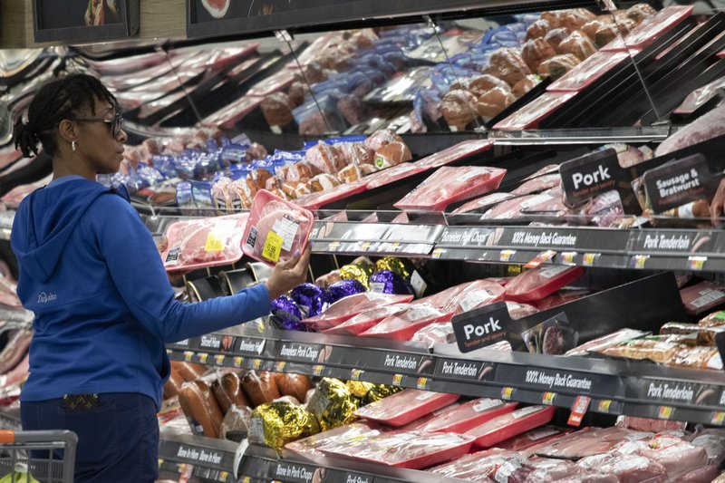 A customer shops at the meat counter at a Walmart Neighborhood Market, Wednesday, April 24, 2019, in Levittown, N. (AP Photo/Mark Lennihan)