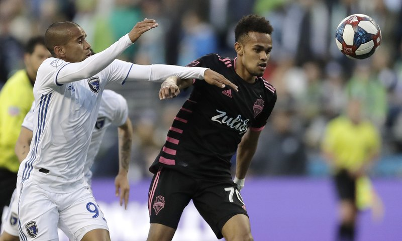 Seattle Sounders midfielder Handwalla Bwana, right, battles for the ball with San Jose Earthquakes midfielder Judson, left, during the first half of an MLS soccer match, Wednesday, April 24, 2019, in Seattle. (AP Photo/Ted S. Warren)
