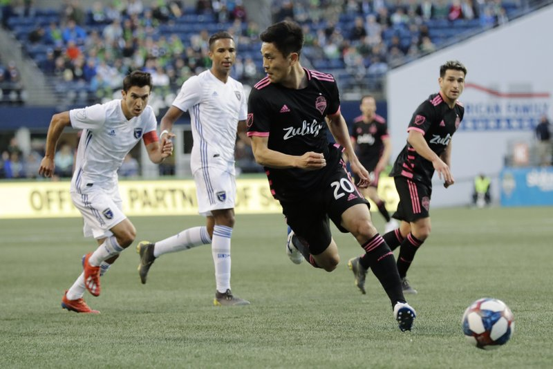 Seattle Sounders defender Kim Kee-Hee (20) looks to pass against the San Jose Earthquakes during the first half of an MLS soccer match, Wednesday, April 24, 2019, in Seattle. (AP Photo/Ted S. Warren)
