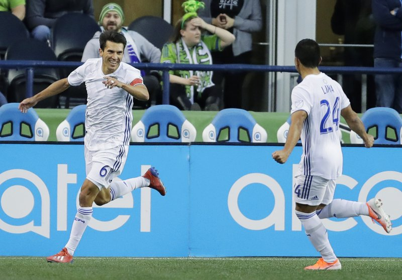 San Jose Earthquakes midfielder Shea Salinas, left, celebrates with Nick Lima, right, after Salinas scored a goal during the first half of an MLS soccer match against the Seattle Sounders, Wednesday, April 24, 2019, in Seattle. (AP Photo/Ted S. Warren)