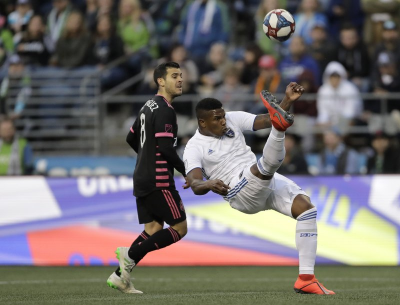 San Jose Earthquakes defender Harold Cummings, right, makes a defensive bicycle kick to clear the ball away from Seattle Sounders midfielder Victor Rodriguez, left, during the first half of an MLS soccer match, Wednesday, April 24, 2019, in Seattle. (AP Photo/Ted S. Warren)