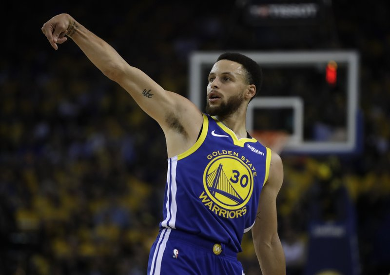 Golden State Warriors' Stephen Curry watches his shot against the Los Angeles Clippers in the first half in Game 5 of a first-round NBA basketball playoff series, Wednesday, April 24, 2019, in Oakland, Calif. (AP Photo/Ben Margot)