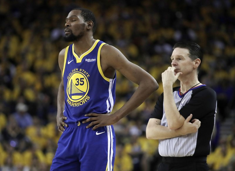 Golden State Warriors' Kevin Durant, left, waits for play to resume in the second half in Game 5 of a first-round NBA basketball playoff series against the Los Angeles Clippers, Wednesday, April 24, 2019, in Oakland, Calif. (AP Photo/Ben Margot)