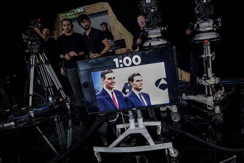 In this Tuesday, April 23, 2019 photo, Spanish election runner Citizens party's Albert Rivera, right, and Prime Minister and Socialist Party candidate Pedro Sanchez on a screen in a studio, prior to the start of the second televised live debate ahead of Sunday's general election in San Sebastian de los Reyes, on the outskirts of Madrid, Spain. (AP Photo/Bernat Armangue)