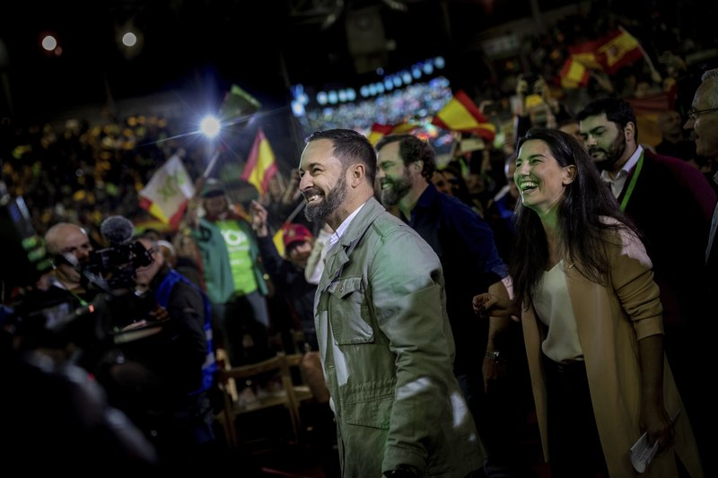 In this Saturday, April 6, 2019 photo, Spain's far-right Vox Party candidate Santiago Abascal smiles to supporters during a VOX event in Leganes, outskirts of Madrid, Spain. (AP Photo/Bernat Armangue)