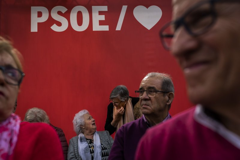 In this Monday, April 15, 2019 photo, Spanish retirees wait for the arrival of Prime Minister and Socialist Party candidate Pedro Sanchez at an election campaign event in Leganes, outskirts of Madrid, Spain. (AP Photo/Bernat Armangue)