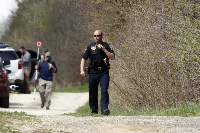 McHenry County Sheriff's officers and other law enforcement search the area of Route 176 and Dean Street south of Woodstock, Ill. (Brian Hill/Daily Herald via AP)