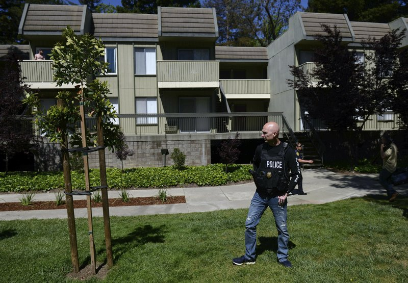 Police work the apartment complex believed to be associated with a car crash suspect in Sunnyvale, Calif. (AP Photo/Cody Glenn)
