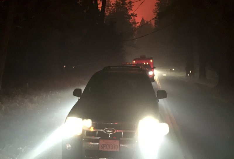 In this Nov. 8, 2018, photo shows vehicles crowded onto a street in Paradise, Calif., fleeing the Camp Fire. (Darrel Wilken via AP)