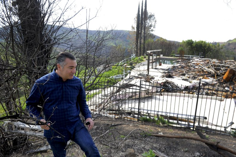 In this April 17, 2019, photo shows Greg Meneshian walking on the side of his Bell Canyon, Calif., property. (Juan Carlo/The Ventura County Star via AP)