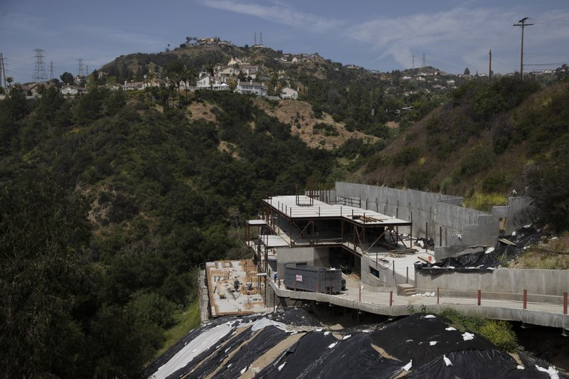 In this April 15, 2019 photo, a homer under construction is seen in the Chevy Chase Canyon neighborhood of Glendale, Calif. (AP Photo/Jae C. Hong)