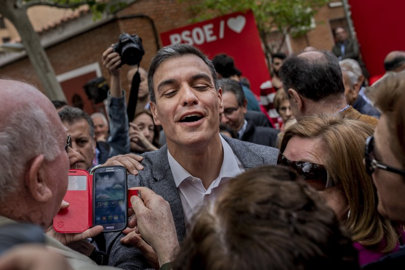 In this Monday, April 15, 2019 photo, Spanish Prime Minister and Socialist Party candidate Pedro Sanchez interacts with retirees at the end of an election campaign event in Leganes, outskirts of Madrid, Spain. (AP Photo/Bernat Armangue)
