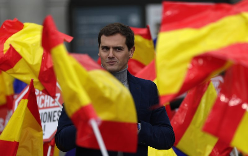 In this Saturday, Nov. 24, 2018 photo, leader of the centre right Ciudadanos party, Albert Rivera, addresses the crowd during political meeting in Madrid, Spain. (AP Photo/Manu Fernandez)