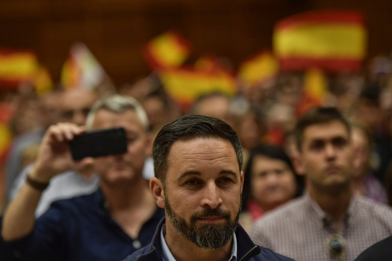 In this Saturday, April 13, 2019 photo, Santiago Abascal, leader of Spanish far right party Vox, takes part in an electoral meeting during the General Election campaign, in San Sebastian, northern Spain. (AP Photo/Alvaro Barrientos)