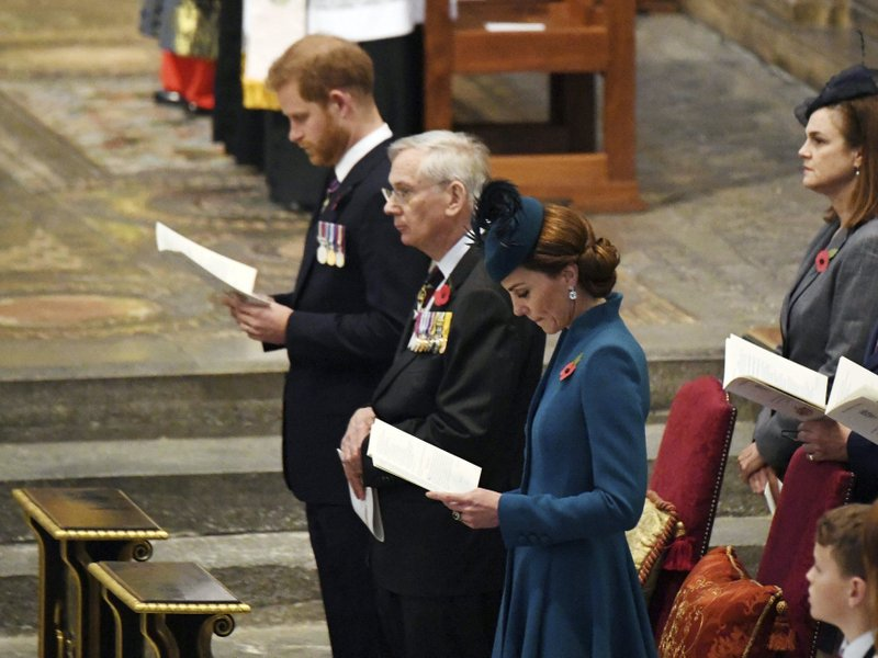 Kate, the Duchess of Cambridge, centre,  Prince Harry, the Duke of Sussex background centre and the Duke of Gloucester attend the Anzac Day Service of Commemoration and Thanksgiving at Westminster Abbey, in London, Thursday April 25, 2019. (Victoria Jones/Pool Photo via AP)
