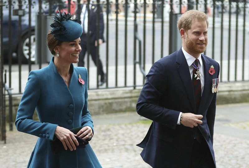 Britain's Prince Harry, right and Kate, the Duchess of Cambridge attend the Anzac Day Service of Commemoration and Thanksgiving at Westminster Abbey, in London, Thursday April 25, 2019. (Andrew Matthews/PA via AP)