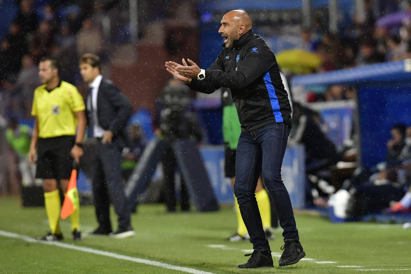 FILE  - In this Saturday, Oct. 6, 2018 file photo, Deportivo Alaves' head manager Abelardo Fernandez, encourages his players during the Spanish La Liga soccer match between Real Madrid and Deportivo Alaves at Mendizorroza stadium, in Vitoria, northern Spain. (AP Photo/Alvaro Barrientos, File)