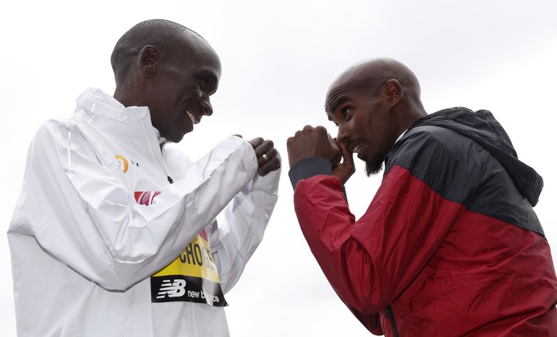 Britain's Mo Farah, right, and Kenya's Eliud Kipchoge pose for the media during a photo call for the London Marathon in London, Wednesday, April 24, 2019. (AP Photo/Alastair Grant)