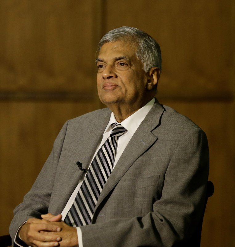 Sri Lankan Prime Minister Ranil Wickremesinghe takes a question during an interview with the Associated Press at his office in Colombo, Sri Lanka, Thursday, April 25, 2019. (AP Photo/Eranga Jayawardena)