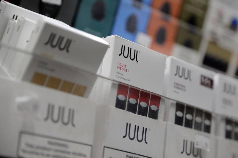 FILE - In this Dec. 20, 2018, file photo Juul products are displayed at a smoke shop in New York. Shares of Altria Group, the nation's largest tobacco company, fell Thursday, April 25, 2019. (AP Photo/Seth Wenig, File)