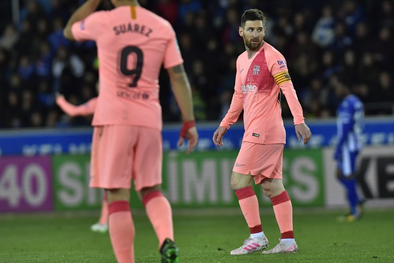 Barcelona forward Lionel Messi looks at the ball during a Spanish La Liga soccer match between Deportivo Alaves and FC Barcelona at the Medizorrosa stadium in Vitoria, Spain, Tuesday, April 23, 2019. (AP Photo/Alvaro Barrientos)