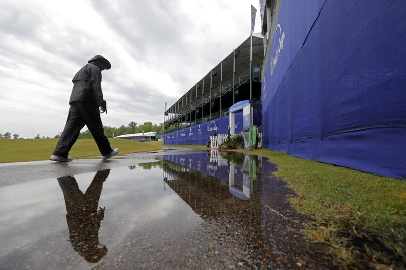 A person walks on the largely empty course during a weather delay for the first round of the PGA Zurich Classic golf tournament at TPC Louisiana in Avondale, La. (AP Photo/Gerald Herbert)