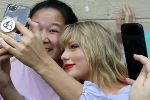 Taylor Swift poses with fans ahead of big announcement
