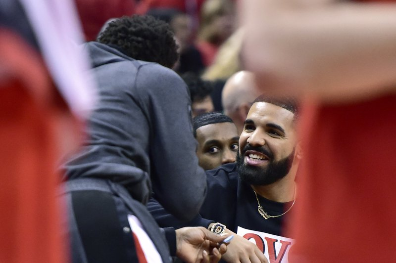 Toronto Raptors guard Kyle Lowry, left, speaks with Drake late in the second half in Game 5 of a first-round NBA basketball playoff series against the Orlando Magic, Tuesday, April 23, 2019 in Toronto. (Frank Gunn/Canadian Press via AP)