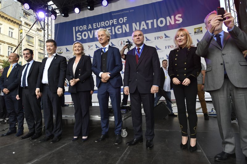 Czech extreme-right Freedom and Direct Democracy party (SPD) head Tomio Okamura, third left, leader of French National Rally Marine Le Pen, fourth left, leader of Dutch Party for Freedom Geert Wilders, fourth right, and others stand at a stage during the rally against