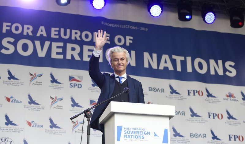 Leader of Dutch Party for Freedom Geert Wilders waves during his speech at a stage during the rally against