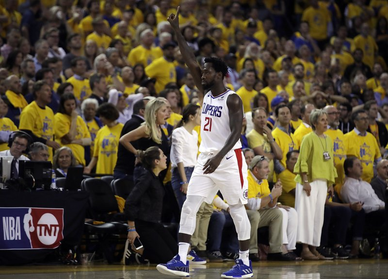 Los Angeles Clippers' Patrick Beverley celebrates in the final minutes of the second half in Game 5 of a first-round NBA basketball playoff series against the Golden State Warriors, Wednesday, April 24, 2019, in Oakland, Calif. (AP Photo/Ben Margot)