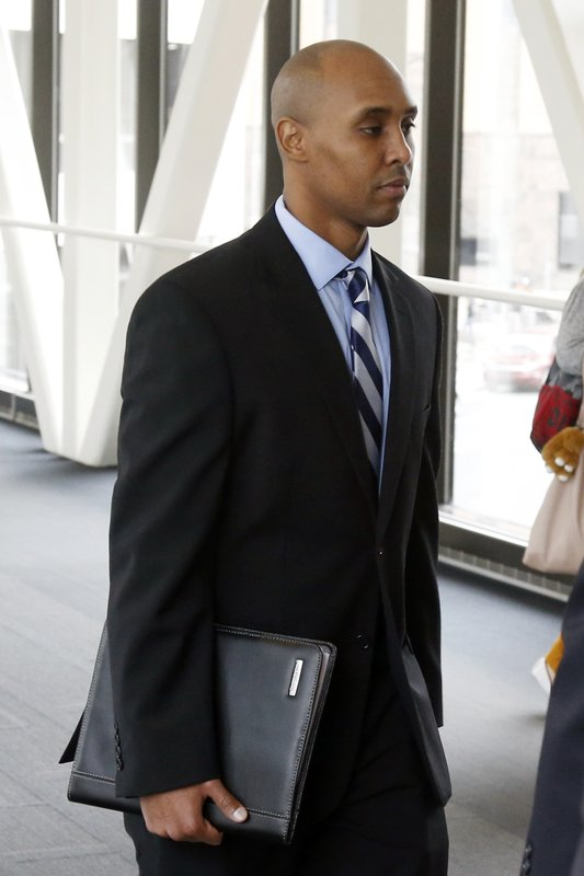 CORRECTS TO APRIL 25, 2019-Mohamed Noor, the former Minneapolis police officer, follows behind his attorneys as he arrives at the Hennepin County Government Center Thursday, April, 25, 2019 in Minneapolis in the fourth week of his trial. (AP Photo/Jim Mone)