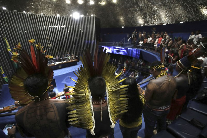 Indigenous leaders meet with lawmakers to discuss land rights and the Chamber of Deputies' role in the protection of the environment in Brasilia, Brazil, Thursday, April 25, 2019. (AP Photo/Eraldo Peres)