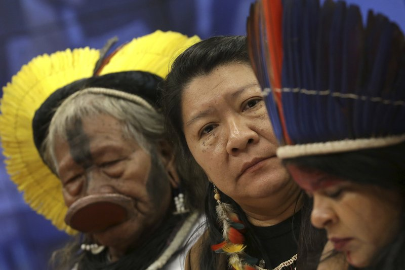 Kayapo leader Raoni Metuktire, from left, Joenia Wapichana, the first indigenous congresswoman to be elected to Brazil's lower house, and indigenous leader Sonia Guajajara, attend a meeting with lawmakers to discuss land rights and the Chamber of Deputies' role in the protection of the environment in Brasilia, Brazil, Thursday, April 25, 2019. (AP Photo/Eraldo Peres)