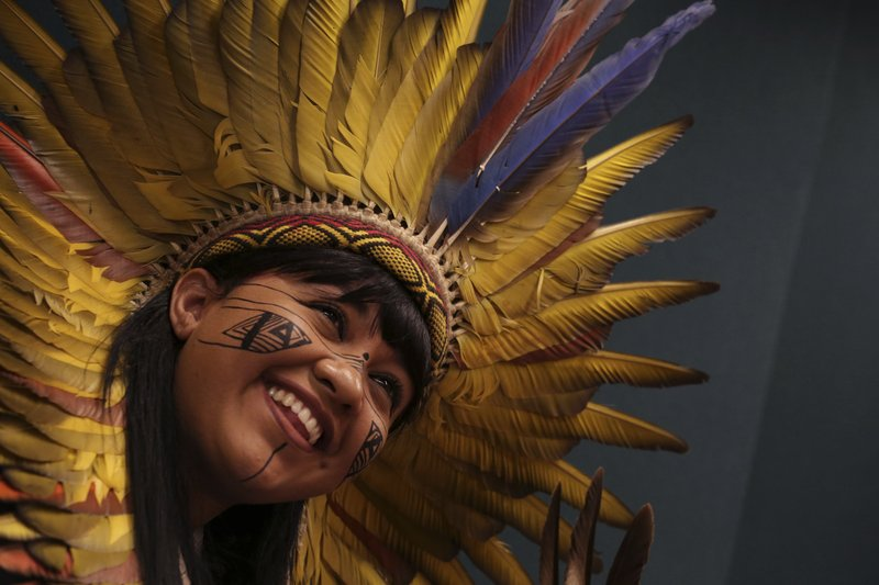 An young Xakriaba indian smiles during a meeting with lawmakers to discuss land rights and the Chamber of Deputies' role in the protection of the environment in Brasilia, Brazil, Thursday, April 25, 2019. (AP Photo/Eraldo Peres)