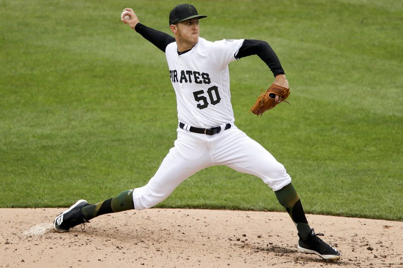 Pittsburgh Pirates starting pitcher Jameson Taillon delivers during the fourth inning of a baseball game against the Arizona Diamondbacks in Pittsburgh, Thursday, April 25, 2019. (AP Photo/Gene J. Puskar)