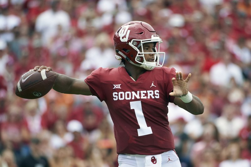 FILE - In this Oct. 6, 2018, file photo, Oklahoma quarterback Kyler Murray (1) throws a pass against Texas during the first half of an NCAA college football game at the Cotton Bowl, in Dallas. (AP Photo/Cooper Neill, File)