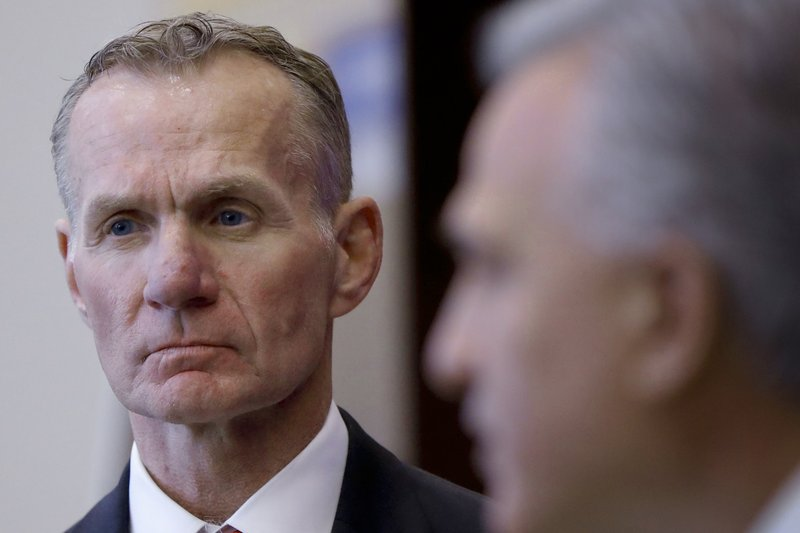 FBI Special Agent in Charge Robert Jones, left, listens as Allegheny County District Attorney Stephen Zappala talks about the efforts and ultimate recovery of the 1615 Breeches Edition Bible that was stolen from the Carnegie Library in Pittsburgh in the 1990's during a news conference, Thursday, April 25, 2019, in Pittsburgh. (AP Photo/Keith Srakocic)