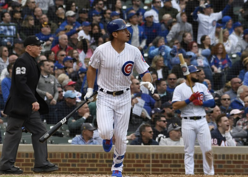 Chicago Cubs' Albert Almora Jr. (5) watches his home run against the Los Angeles Dodgers during the ninth inning of a baseball game, Thursday, April, 25, 2019, in Chicago. (AP Photo/David Banks)