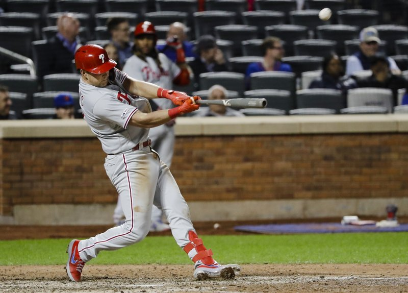 Philadelphia Phillies' Rhys Hoskins hits a two-run home run during the ninth inning of a baseball game against the New York Mets, Wednesday, April 24, 2019, in New York. (AP Photo/Frank Franklin II)