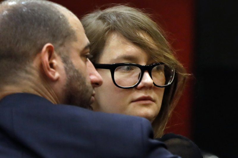 Anna Sorokin and her lawyer Todd Spodek look to the courtroom audience during jury deliberations in her trial at New York State Supreme Court, in New York, Thursday, April 25, 2019. (AP Photo/Richard Drew)