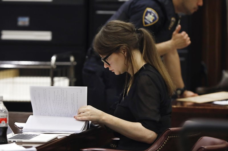 Anna Sorokin looks over court documents during jury deliberations in her trial at New York State Supreme Court, in New York, Thursday, April 25, 2019. (AP Photo/Richard Drew)